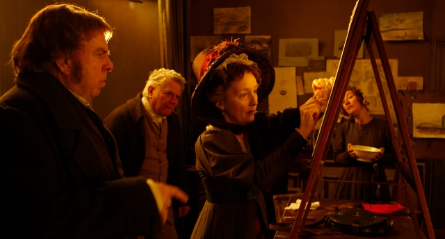 Mary Somerville (Lesley Manville) prepares to demonstrate her experiment on violet light to J.W.M. Turner (Timothy Spall) and his household (Paul Jesson & Dorothy Atkinson) in Mike Leigh's 2014 film Mr Turner.
