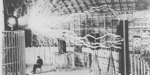 Nikola Tesla lived a life of contradictions. Tesla was equal parts showman and inventor, and these qualities underpinned his success and contributed to his downfall. A multiple-exposure photograph shows Tesla in his Colorado Springs laboratory, where he explored wireless telegraphy and produced artificial lightning.  (The Tesla Collection)