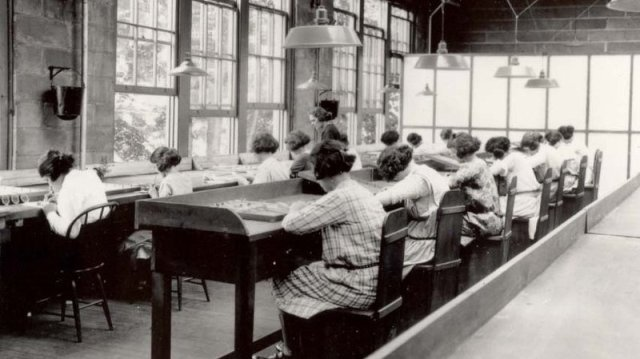 "Employees of the U.S. Radium Corp. paint numbers on the faces of wristwatches using dangerous radioactive paint. Dozens of women, known as ""radium girls,"" later died of radium poisoning. The last radium girl died this year at 107. Argonne National Laboratory"