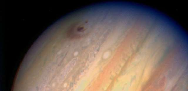 Image of Jupiter showing impact sites from Comet Shoemaker-Levy 9, taken July 18, 1994. (Photo: H. Hammel, MIT and NASA)