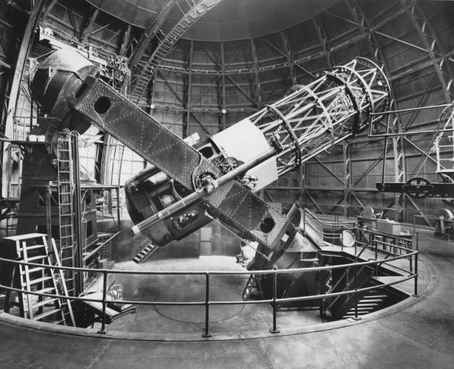 The Hooker 100-inch reflecting telescope at the Mount Wilson Observatory, just outside Los Angeles. Edwin Hubble's chair, on an elevating platform, is visible at left. A view from this scope first told Hubble our galaxy isn't the only one. Courtesy of The Observatories of the Carnegie Institution for Science Collection at the Huntington Library, San Marino, Calif.