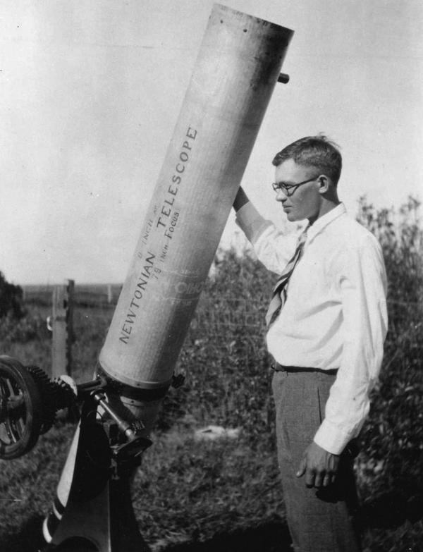 "Clyde Tombaugh with his ""automobile"" telescope"