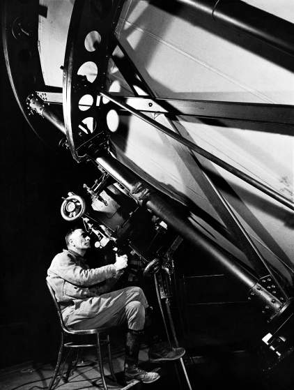 Astronomer Edwin Powell Hubble looking though the eyepiece of the 100-inch telescope at the Mt. Wilson Observatory. MARGARET BOURKE-WHITE—THE LIFE PICTURE COLLECTION/GETTY IMAGES