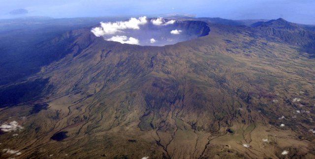 The deep volcanic crater, top, was produced by the eruption of Mount Tambora in Indonesia in April 1815 - the most powerful volcanic blast in recorded history. Credit Iwan Setiyawan/KOMPAS, via Associated Press