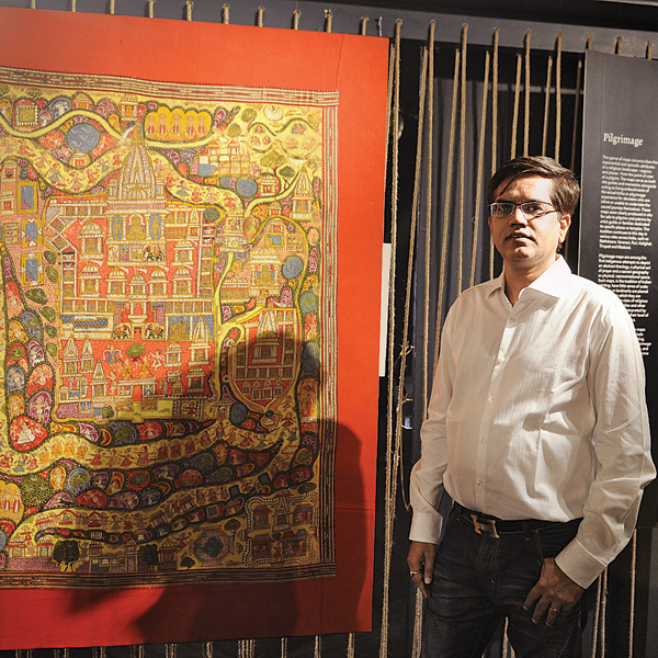 Prashant Lahoti with a pilgrimage route map of Shatrunjaya, a holy site for Jains located in Palitana, Gujarat; c. 1750. The map is on display at the National Museum in Delhi Manit Balmiki dna