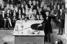 Michael Faraday delivering a Christmas Lecture at the Royal Institution in 1856. Source: Wikimedia Commons
