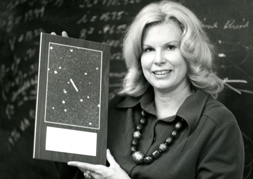 Dr. Helin holding the discovery image for asteroid Ra-Shalom, circa 1979. (Helin Family Estate)