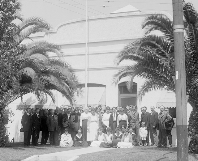 Unidentified women and men standing outside the Mount Wilson Observatory's Pasadena office, where women computers made the calculations necessary to answer some of the most profound questions in the field of astronomy during the early part of the 20th century. Detail from a photo taken on April 14, 1917, by an unknown photographer. The Huntington Library, Art Collections, and Botanical Gardens.
