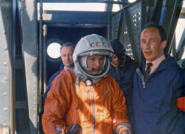 "Gagarin being led to his spaceship at the top of the gantry by Oleg Ivanovsky who was the ""lead"" (production) designer of the Vostok spaceship."