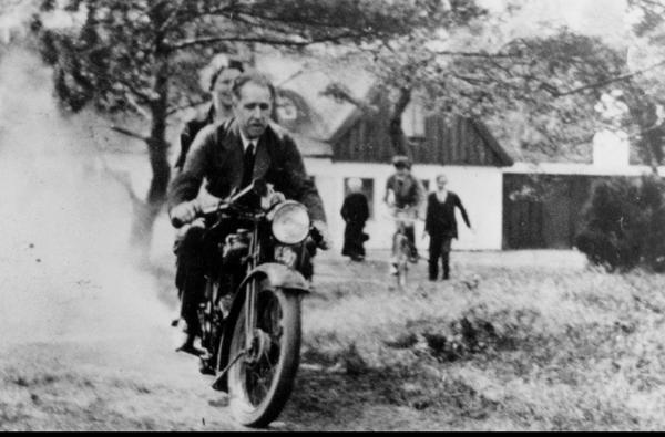 Niels Bohr on G. Gamow's motorcycle, with his wife Margrethe sitting behind. Photo credit Emilio Segrè Visual Archives h/t Alex Wellerstein