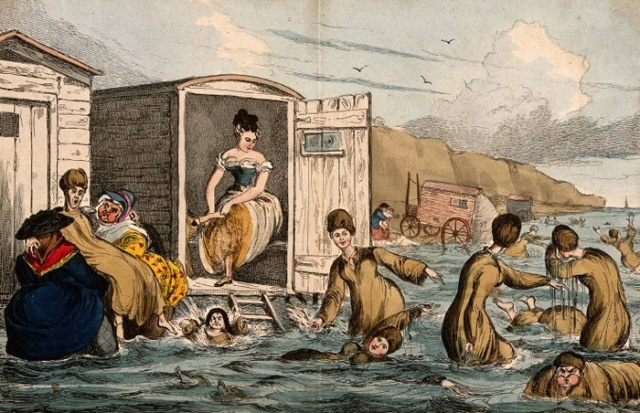 V0012256 Humorous image of society ladies trying to swim, Brighton. C Credit: Wellcome Library, London. Wellcome Images images@wellcome.ac.uk http://wellcomeimages.org Humorous image of society ladies trying to swim, Brighton. Coloured etching by W. Heath after himself. By: William HeathPublished: -