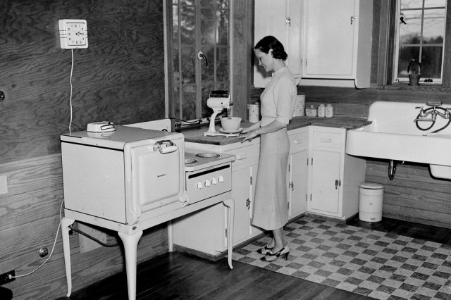 Mrs. H.M. Richardson, Tennessee Valley Authority (TVA) housewife is shown as she prepares a meal in her all-electric kitchen in Morris, Tenn., on January 15, 1936. (AP Photo)