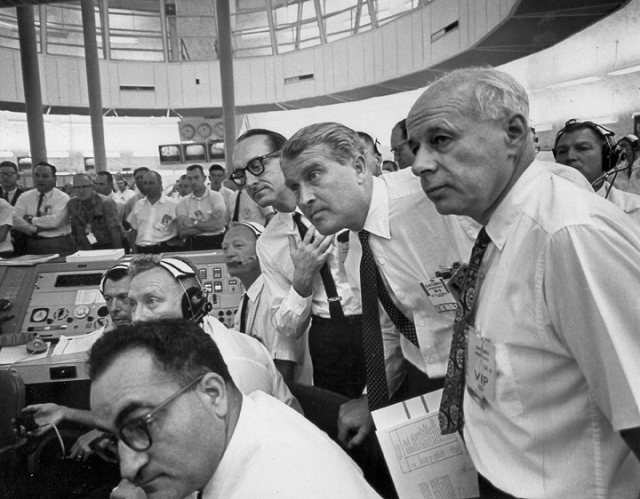 A tense moment during the AS-101 launch. Standing, from left to right are George Mueller, Wernher von Braun, and Eberhard Rees (Director for Research and Development at MSFC). Source: Wikimedia Commons