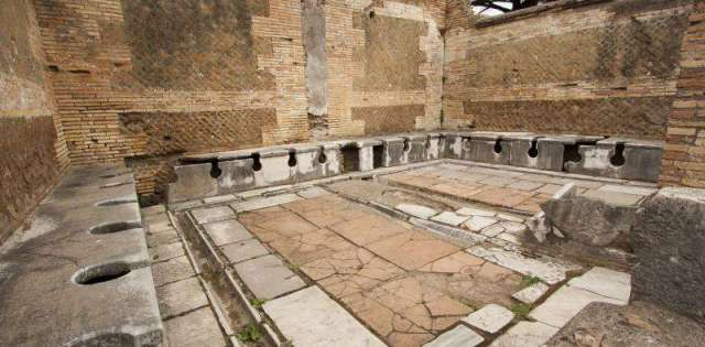 Ruin of a second-century public toilet in Roman Ostia. Credit: Fr Lawrence Lew, OP, CC BY-NC-ND
