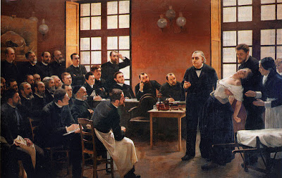 André Brouillet's 1887 A Clinical Lesson at the Salpêtrière depicting a Charcot demonstration. Freud had a lithograph of this painting placed over the couch in his consulting rooms.