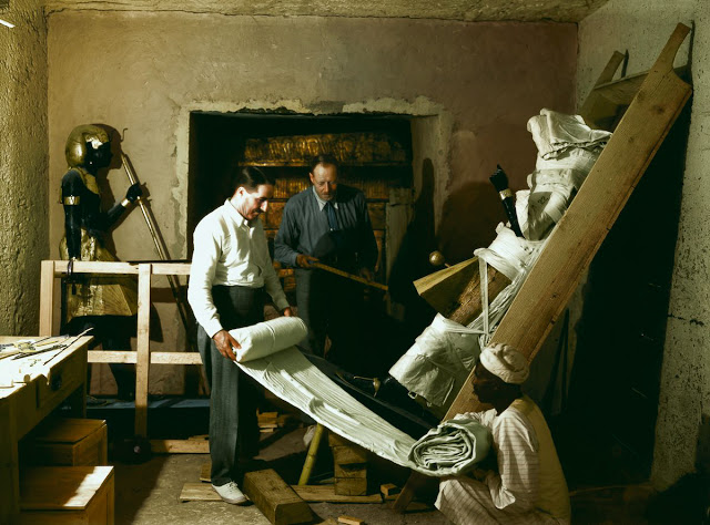 29th November 1923, Tutankhamun's Tomb | Howard Carter (on the left) working with his friend and colleague Arthur Callender on wrapping one of two sentinel statues of Tutankhamun (Carter no. 22) found in the Antechamber, before their removal to the 'laboratory' set up in the tomb of Sethos II (KV 15). These statues had been placed either side of the sealed entrance to the Burial Chamber.