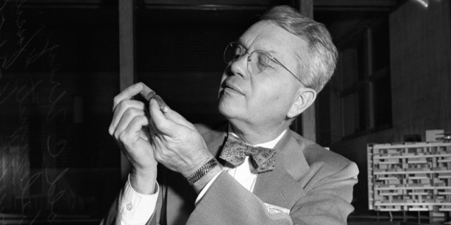 After helping create the atom bomb as part of the Manhattan Project, Harold Urey focused on uncovering the age and origins of Earth and the solar system. In this 1951 photo Urey inspects a 'fossilized thermometer' of belemnite (a prehistoric squid-shaped creature). Urey used information from these fossils to estimate the temperature of oceans from as far back as 100 million years. (USC Digital Library)
