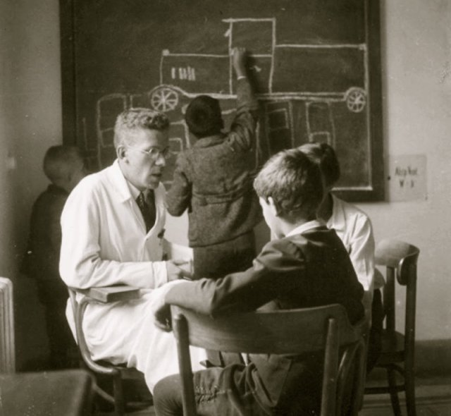 Dr. Hans Asperger with a young boy at the Children's Clinic at the University of Vienna in the 1930s. Courtesy of Maria Asperger Felder