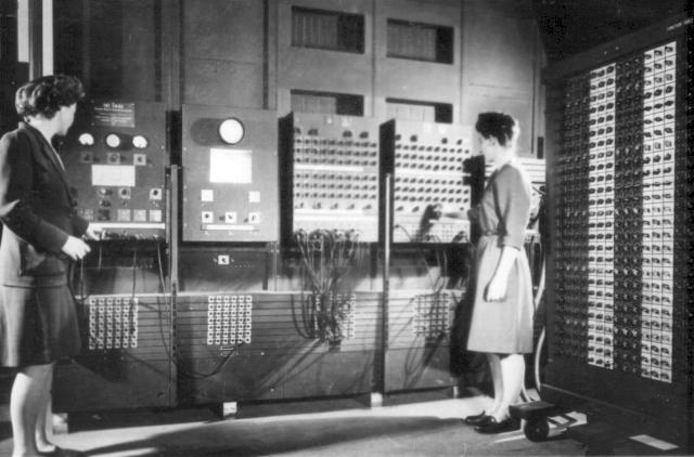 Betty Jennings (left) and Frances Bilas (right) operating ENIAC's main control panel.