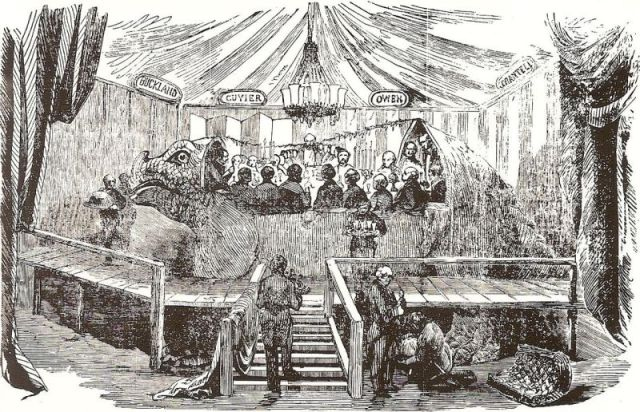Dinner in the Iguanodon Model, at the Crystal Palace, Sydenham, London Illustrated News, 7 January 1854 (image in public domain).