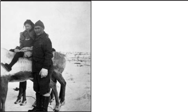 Figure 1. Frank Taller and his daughter sitting on a reindeer, Levelock area, circa 1930. Courtesy of Alex Tallekpalek and the National Park Service, Museum  Management Program and Katmai National Park and Preserve; H-410