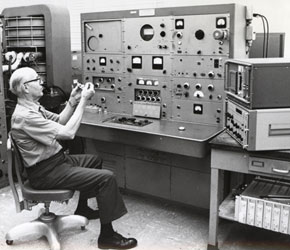 Glyn R. Taylor, operator, prepares a sample for introduction into the heated inlet system of Consolidated Engineering Corporation Model 21-103 Mass Spectrometer, May 1974. CHF Collections.