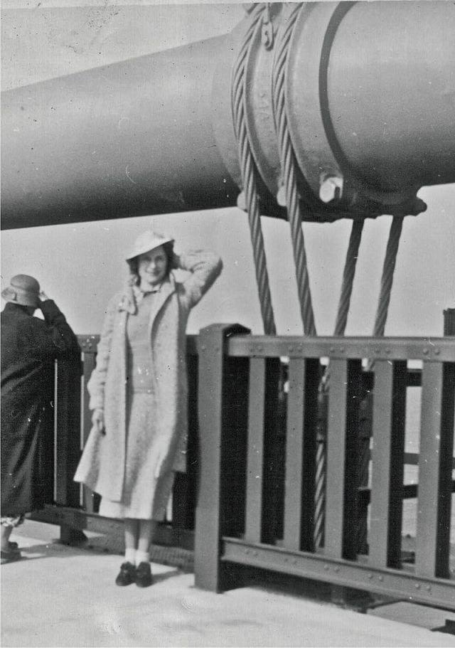 A pedestrian poses at the old railing on opening day, 1937 Source: Wikimedia Commons