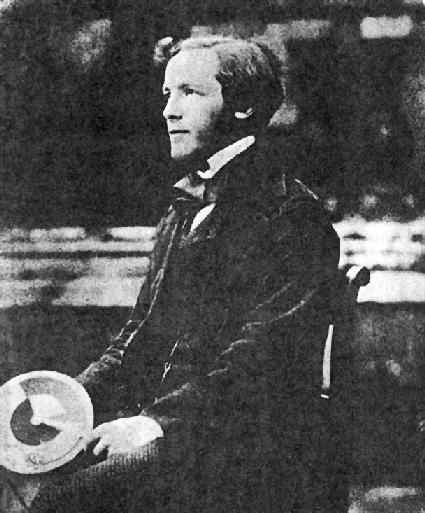 A young Maxwell at Trinity College, Cambridge. He is holding one of his colour wheels. Source: Wikimedia Commons