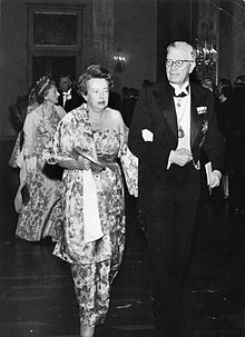 Maria Goeppert Mayer walking into the Nobel ceremony with King Gustaf VI Adolf of Sweden in 1963 Source: Wikimedia Commons