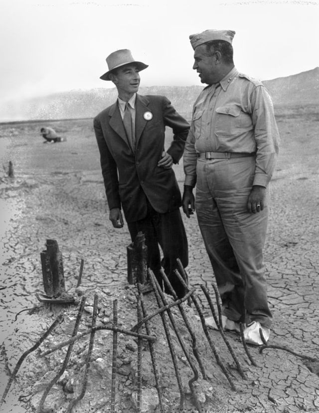 Oppenheimer and General Groves visiting the remains of the Trinity test tower in September 1945.