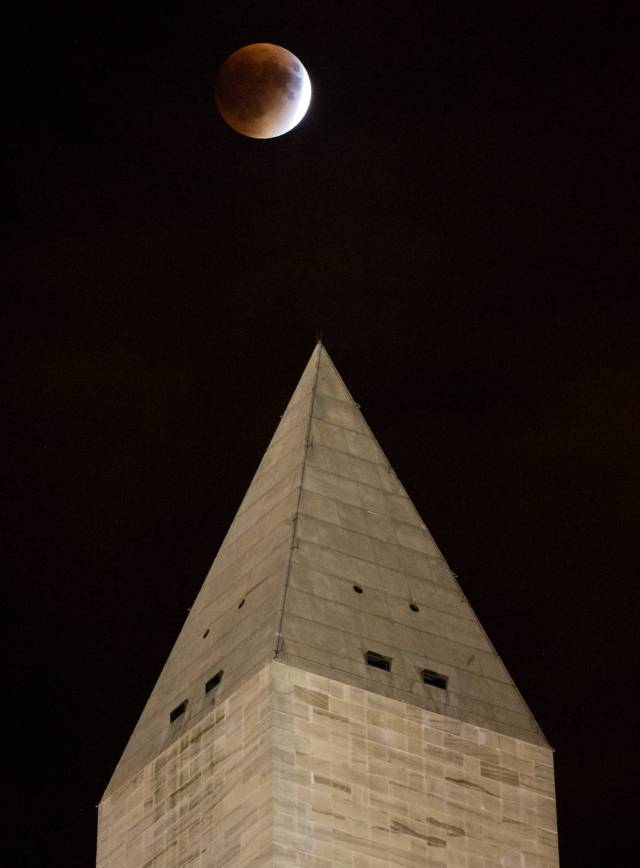 A perigee full moon, or supermoon, is seen behind the Washington Monument during a total lunar eclipse on Sunday, September 27, 2015, in Washington, DC. The combination of a supermoon and total lunar eclipse last occurred in 1982 and will not happen again until 2033.  Photo Credit: (NASA/Aubrey Gemignani)