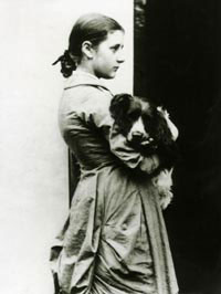 Potter at fifteen years with her springer spaniel, Spot Source: Wikimedia Commons
