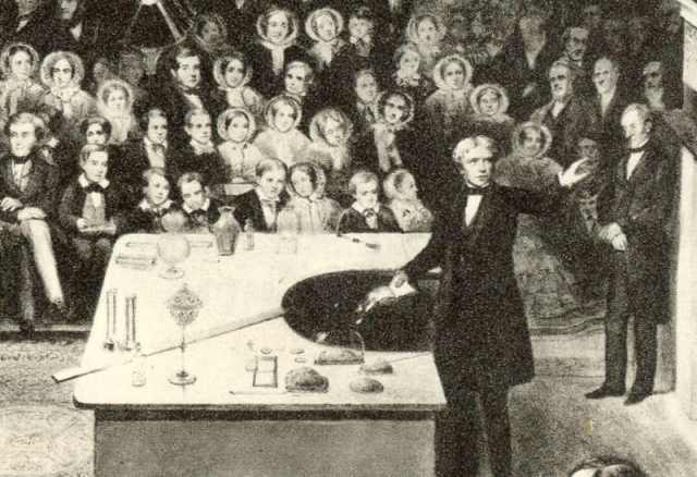 Michael Faraday, shown delivering the British Royal Institution's Christmas Lecture for Juveniles during the Institution's Christmas break in 1856 Source: Wikimedia Commons