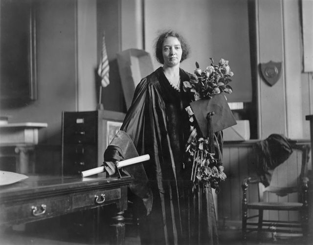Physicist Irène Joliot-Curie (1897-1956) is shown in full academic regalia on May 23, 1921 Photo by James Stokley Source Wikimedia Commons