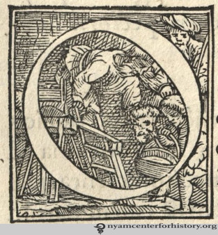 A historiated initial showing a decapitated head being passed down from a scaffold, published in de humani corporis fabrica (1543).