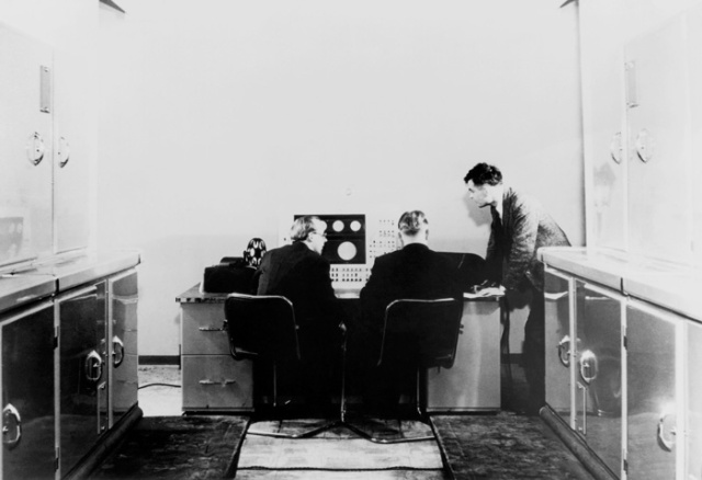 Alan Turing and colleagues working on the Ferranti Mark 1 computer. Science Museum,