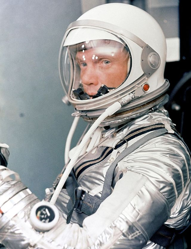 Astronaut John H. Glenn Jr. dons his silver Mercury pressure suit in preparation for launch of Mercury Atlas 6 (MA-6) rocket. Source: NASA via Wikimedia Commons