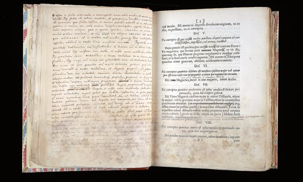 A page from Principia Mathematica, right, with Newton's notes opposite, held at Cambridge University. A European first edition could sell for up to $1.5m. Photograph: Cambridge University Library