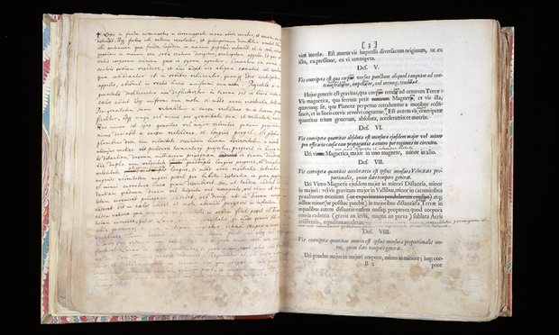 A page from Principia Mathematica, right, with Newton's notes opposite, held at Cambridge University. A European first edition has sold for £3m. Photograph: Cambridge University Library