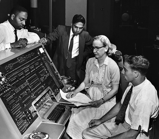Grace Murray Hopper at the UNIVAC keyboard, c. 1960. Grace Brewster Murray: American mathematician and rear admiral in the U.S. Navy who was a pioneer in developing computer technology, helping to devise UNIVAC I. the first commercial electronic computer, and naval applications for COBOL (common-business-oriented language). Credit: Unknown (Smithsonian Institution)