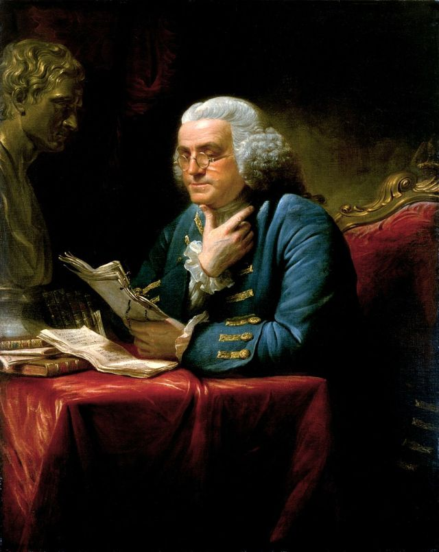 Franklin in London, 1767, wearing a blue suit with elaborate gold braid and buttons, a far cry from the simple dress he affected at the French court in later years. Painting by David Martin, displayed in the White House. Source: Wikimedia Commons