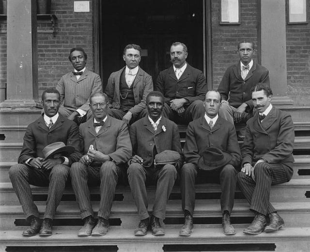 George Washington Carver seated (front row, center) on steps at the Tuskegee Normal and Industrial Institute, with staff, ca. 1902. Photo by Frances Benjamin Johnston. Library of Congress Prints and Photographs Division. LC-DIG-ppmsca-05633.