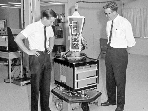 SRI researchers Nils Nilsson (right) and Sven Wahlstrom with Shakey the Robot in the late 1960s. Photo: SRI International